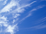 Whispy Stark White Cirrus Clouds in a Vast Blue Sky  Australia