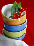 Pile of Soup Bowls with Tomato  Bay Leaf and Chilis