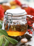 Honey with Chestnuts and Almonds in Jar