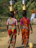 Women from Khilabandar Balance Containers of Water on their Heads