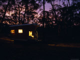 Welcoming Lit Up Gypsy Wagon in the Forest at Sunset  Australia