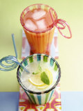 Ice-Cold Lemonade and Pink Grapefruit Juice in Glasses