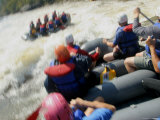 Whitewater Rafters Paddle Through Rapids