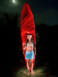 Woman Stands by a Big Wave Surf Board under a Full Moon  Hawaii