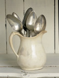 Old Silver Spoon in Light Coloured Ceramic Jug