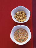 Honey Peanut Sauce and Peanuts in Small Bowls
