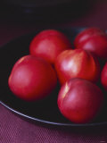 Several Nectarines in a Black Dish