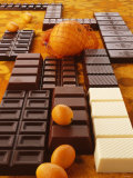 Still Life of Chocolate Bars and Citrus Fruit