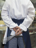 Chef with a Whisk in His Hand