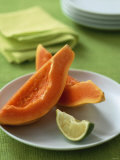 Two Papaya Wedges on a Plate