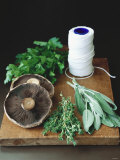 Mushrooms  Fresh Herbs &amp; Kitchen String on Chopping Board