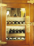 Several Wine Bottles in Wood-Panelled Drinks Cabinet