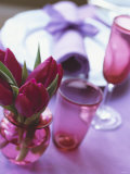 Red Tulips in Small Vase Beside Place Setting