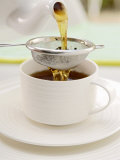 Pouring Tea Through a Tea Strainer