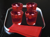 Water and Ice Cubes in Red Glasses on Tray