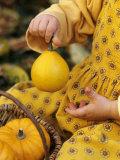 Girl Holding a Baby Pumpkin