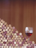 Wine Corks  Piled Up  and a Glass of Red Wine