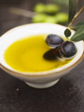 Olive Oil in Small Bowl with Black Olives