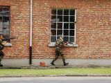 Belgian Soldiers on Patrol around a Suspect Building