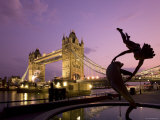 Tower Bridge and Girl with a Dolphin Fountain Statue at Dusk  London  England