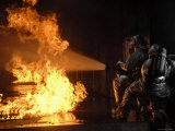 Firefighters Extinguishing a Simulated Battery Fire