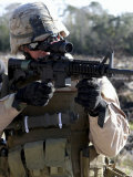 Soldier Looks Through the Scope of M-4 Carbine Rifle