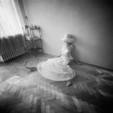 Pinhole Camera Shot of Sitting Topless Woman in Hoop Skirt