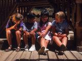 Children Sitting in Playground