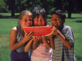 Children in Park Eating Watermelon