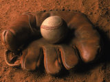 Baseball Glove with Ball on Dirt