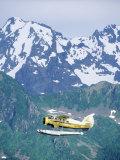 Seaplane in Flight Near Mountains  AK