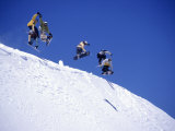 Snowboarders Jumping off Overhang  CO