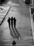 Three Boys Walking Down Street Arm in Arm