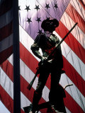 US Flag with Silhouetted Statue of Soldier
