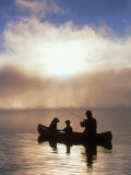 Silhouetted Father and Son Fishing from a Canoe