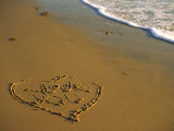 Heart and &quot;Love You&quot; Carved Into Beach Sand with Tid