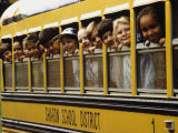 School Children Looking Out School Bus Windows