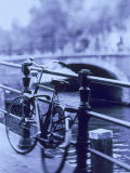 Bicycle on Rail by Canal  Amsterdam  Netherlands