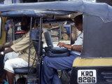 Man Uses Laptop in Back Seat of Rickshaw  India