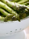 Asparagus  Washed Green Asparagus Spears in a Colander