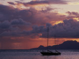 Sailboat in Shallow Water and Sunset