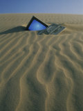 Computer Buried in Sand