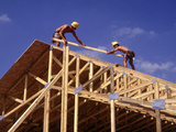 Construction Workers Framing a House