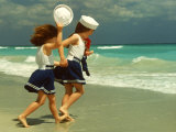 Two Girls in Sailor Suits Running on Beach