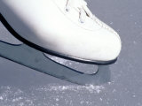 Close-up of Figure Skate on Ice