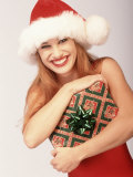 Woman in Santa Hat Holding Gift