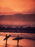 Surfers at Sunset  Oahu  Hawaii