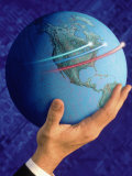 Businessman&#39;s Hand Holding Globe