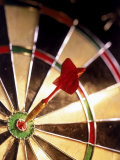 Dart in Bull&#39;s Eye of Dart Board