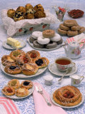 Table Set with Tea and Various Pastries
